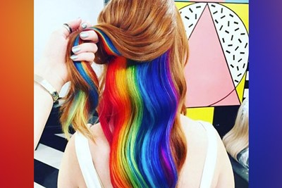 A woman with rainbow hair