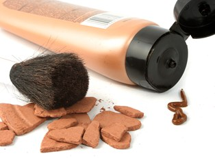 a tube of self-tanner and other makeup products