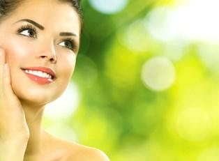 a woman enjoys her light makeup during the heat of summer