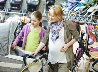 Stylish pregnant woman shopping