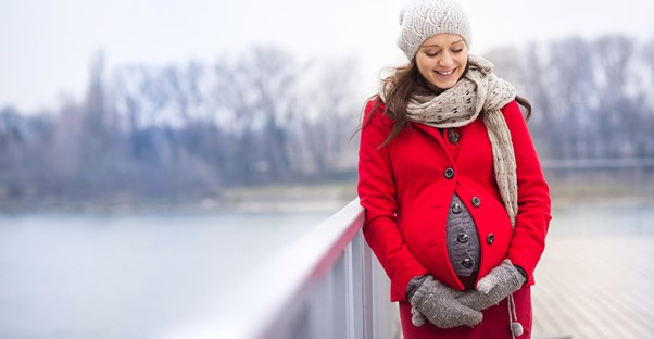 Pregnant woman showing of her maternity wardrobe