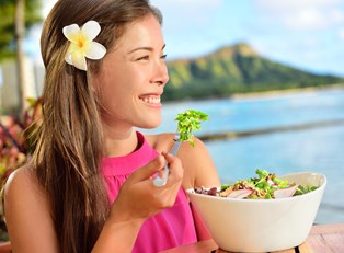 Woman enjoying a salad in Hawaii