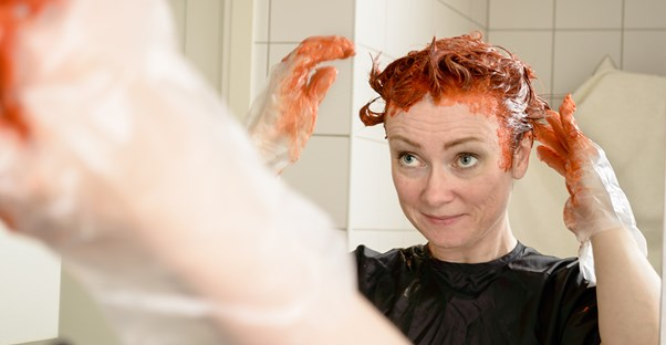 Woman dying her hair at home.