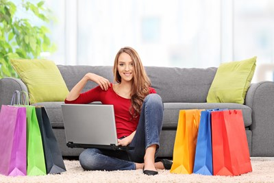 a woman shopping at an online fashion boutique