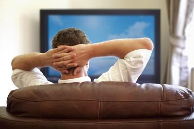 Man enjoying watching television