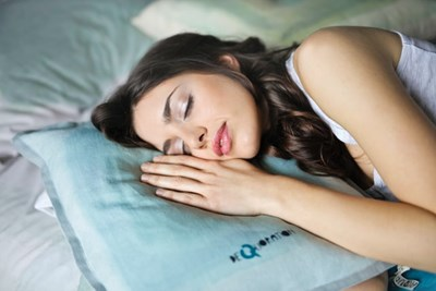 A man with a bunch of puppies