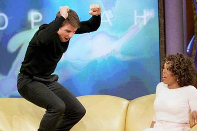 tom cruise jumping up and down on a couch on the oprah winfrey show