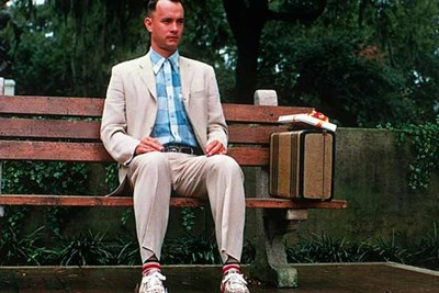 tom hanks as forest gump sits on a bus bench