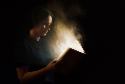 A girl reads the wild events happening in the Bible.