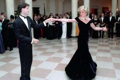Princess Diana in a black gown dancing with John Travolta.