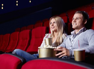 A couple watching the new hunger games movie