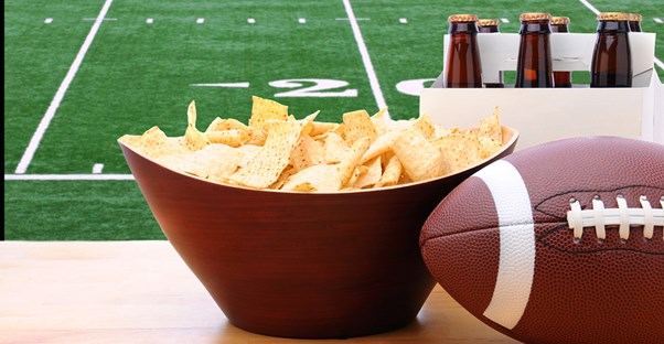 Chips and beer at a Super Bowl watch party.