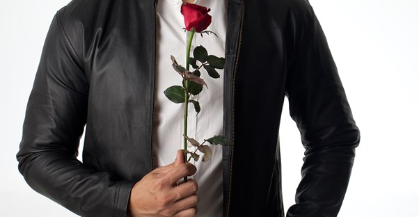 A bachelor with a red rose.