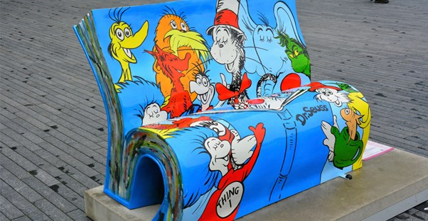 A bench painted in Dr. Seuss characters.