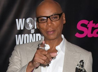 RuPaul pointing at the camera