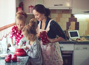 A mother and her daughters making healthy baked goods