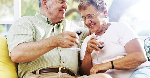 An older couple enjoying a glass of wine