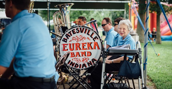 an older retired woman participates in a band