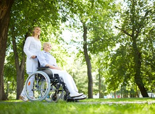 An elderly woman enjoys quality senior care paid for through long term care insurance.