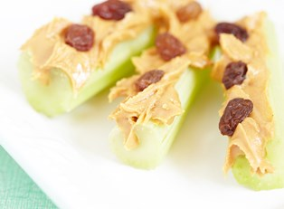 A healthy snack of celery and peanut butter given to a kid who hates healthy food.