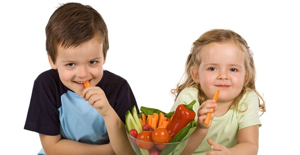 A brother and sister eat healthy, immune boosting snacks.