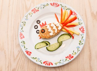 A healthy, quick snack for kids made out of veggies and crackers.