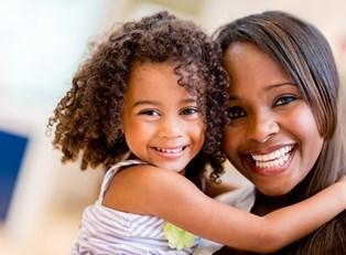 A little girl hugging her mom.