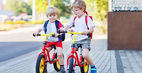 Two brothers riding bikes