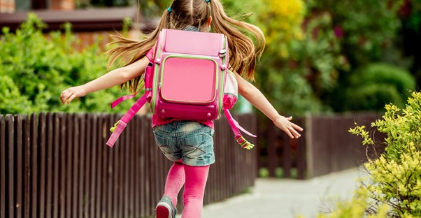 Young girl excitedly going to school
