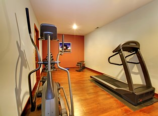 a home gym with treadmill, elliptical,and free weights