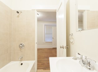 a rent house bathroom looks completely remodeled without any major renovation