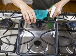 a stovetop gets a deep srubbing