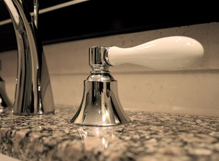 A recently remodeled sink invites buyers to make an offer on the house.