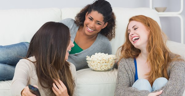 three friends enjoy an emmy watch party
