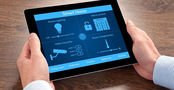 A man operates his home automation system from his tablet.