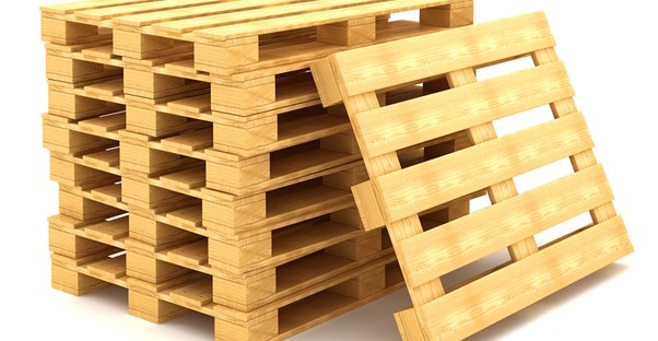 A stack of pallets to be turned into garage pallet racks