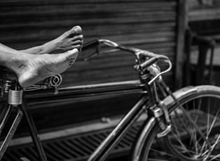 black and white photo of a bike
