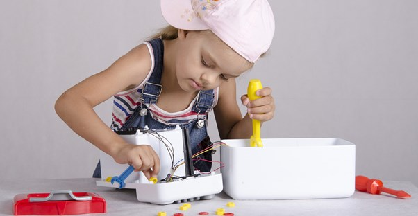 A child repairing a dangerous appliance