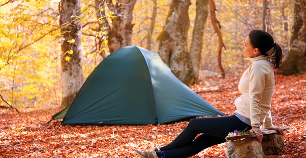Woman wonders what she forgot to pack for her fall camping trip