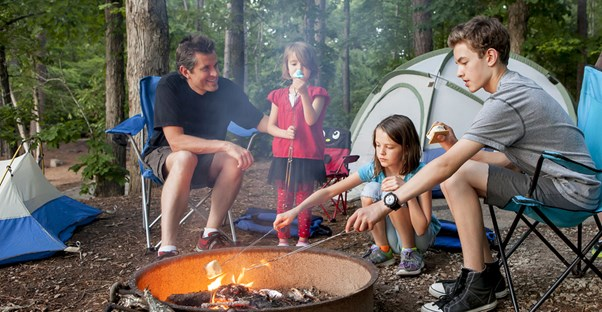 A family practicing camp fire saefty