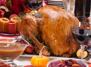 Thanksgiving dinner sitting on a table waiting to be eaten as the family discuss what they are grateful for