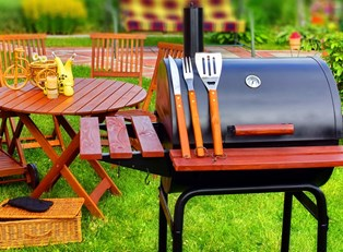 A grill set up with helpful gadgets and accessories