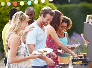 A group of friends enjoying the perfect cookout party.