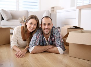 Couple Smiling in their new home because they had a smooth move