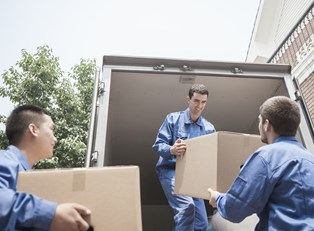 Movers helping a family relocate
