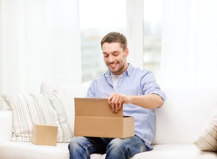 A man excitedly opening a gift