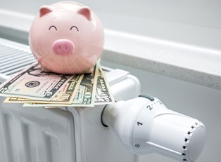A happy piggy bank showing the money saved by using an energy efficient heater.