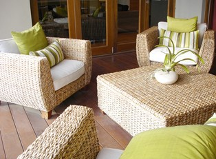 Patio furniture that has been protected by outdoor furniture covers.