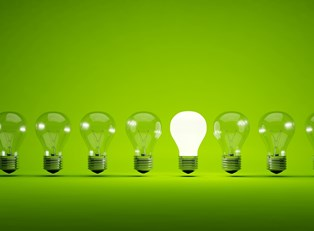 A row of light bulbs on a green background.