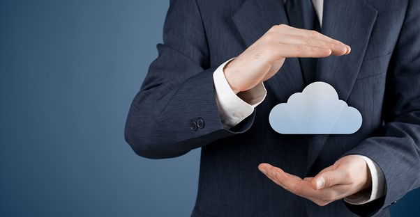 A man in a business suit holding a digital cloud image.
